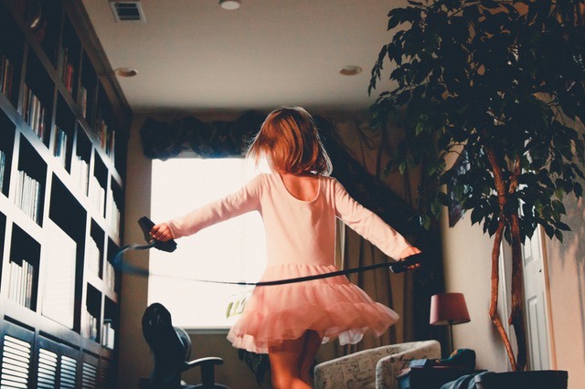 girl playing in living room