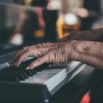 senior playing piano