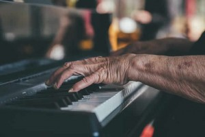 senior playing piano