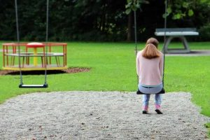 woman alone on a child's swing