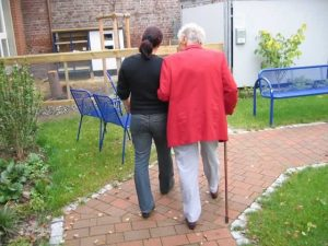 Woman walking an elderly woman